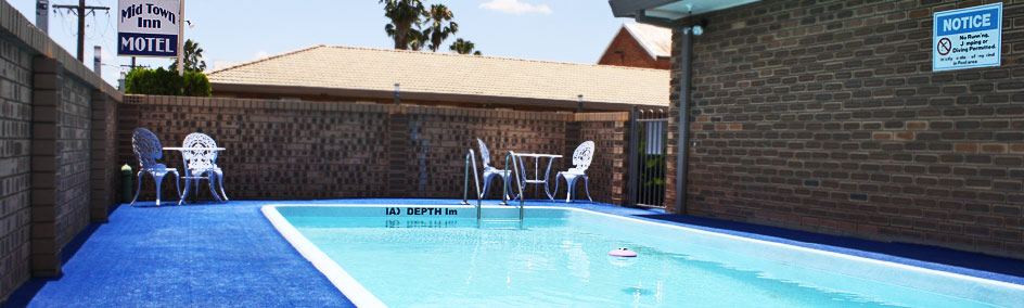 Relax by the pool at Mid Town Inn Narrabri